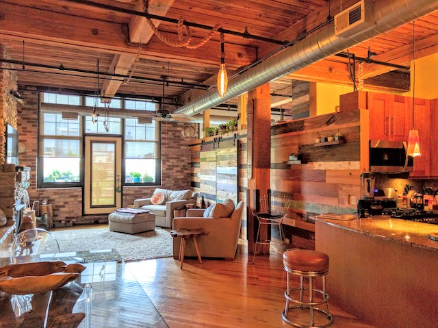 living room of loft apartment for rent in West Loop Chicago with bespoke wooden decor