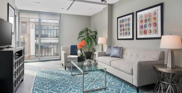 living room with floor-to-ceiling glass window in apartment for rent at 1241 Milwaukee in Chicago