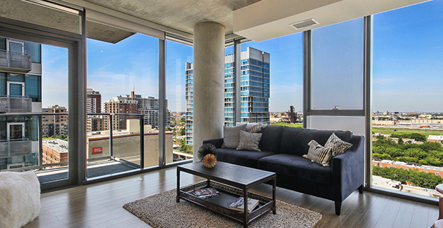 living room with floor to ceiling glass windows and concrete column with views over Chicago southwest side from apartment for rent in 1333 South Wabash