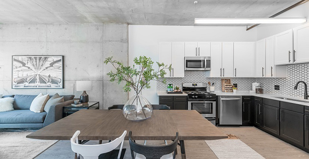 urban loft apartment with concrete ceilings and custom tile kitchen backsplash in South Loop apartment for rent in 1401 South State Apartments, Chicago