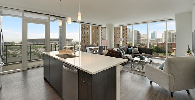 kitchen and living room with view of Soldier Field in South Loop, Chicago