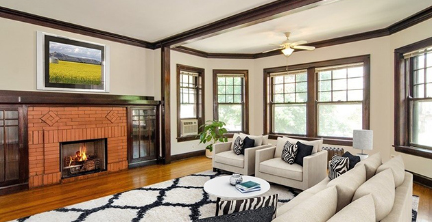 living room of vintage apartment for rent in Chicago with original fireplace and woodwork