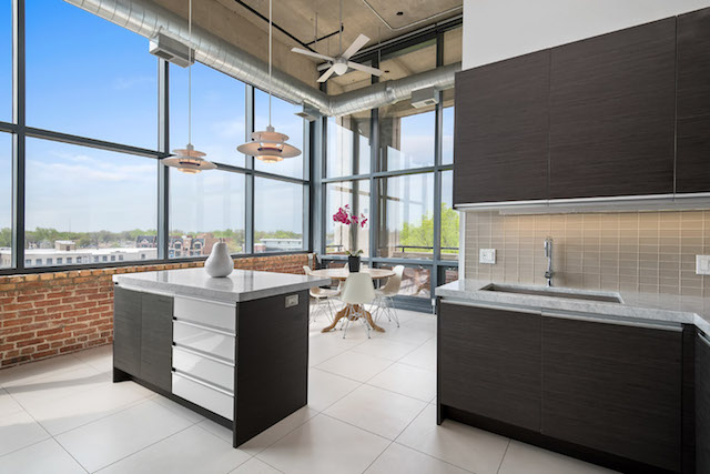 kitchen and dining room of contemporary concrete loft apartment in Ravenswood Chicago