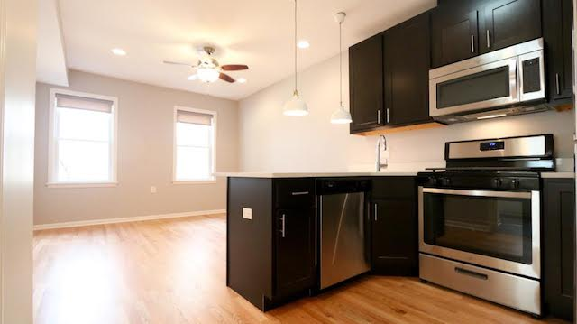updated kitchen with peninsula for entertaining in 2 bedroom apartment for rent in Pilsen Chicago