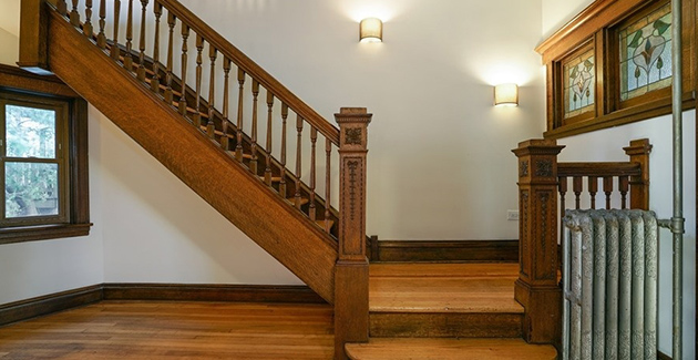 wooden railing and landing of staircase in vintage apartment in Humboldt Park Chicago
