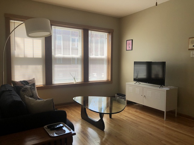 living room with glass mid-century coffee table in Avondale 1 bedroom apartment for rent