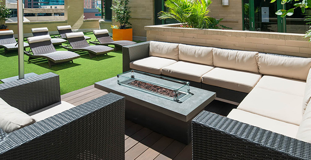 lounge chairs around fire pit on rooftop deck of Streeterville apartments for rent at 420 E Ohio