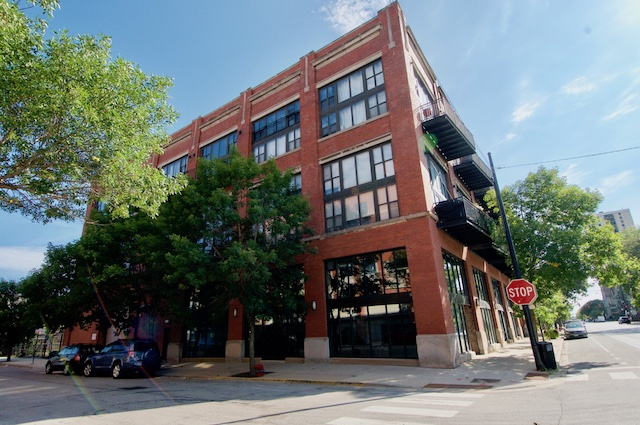 exterior of brick warehouse loft apartment building in Chicago South Loop