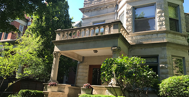 front porch of vintage greystone mansion in Lincoln Park, Chicago