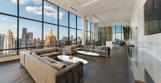 view from floor-to-ceiling windows in Sky Lounge of 73 E Lake apartments in the Chicago Loop