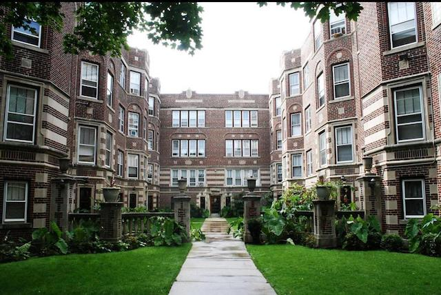 exterior of vintage brick courtyard apartment building in Rogers Park Chicago