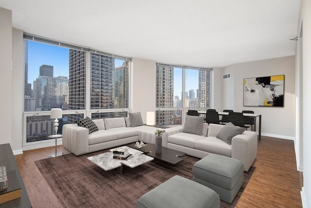 living room and dining area with view of downtown Chicago from River North apartment