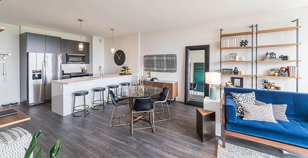 dining room with kitchen and living room in Eight Eleven Uptown apartments in Chicago
