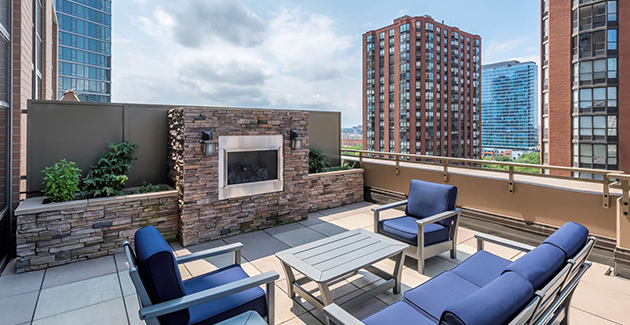 lounge furniture beside a rooftop fire pit at Astoria Tower apartments for rent in the South Loop