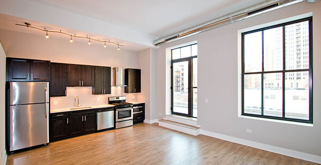 kitchen and wall of windows in loft apartment for rent in Aviation Lofts, South Loop, Chicago
