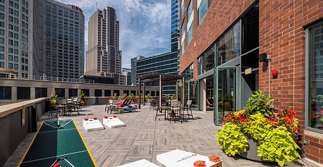open air patio in Streeterville neighborhood with lawn games at Cityfront Place apartments