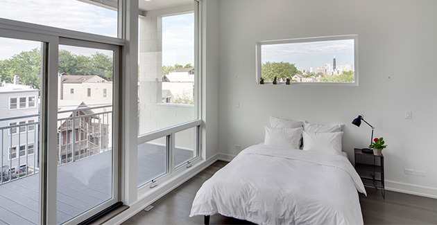 bedroom with sliding glass doors opening onto private patio in Ukrainian Village apartment for rent