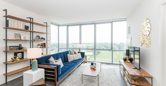 living room with floor to ceiling windows and view of Lake Michigan from Uptown apartment building Eight Eleven Uptown