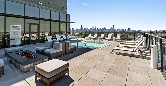 rooftop deck at Lincoln Park apartment building Elevate with lounge seating and fire pit