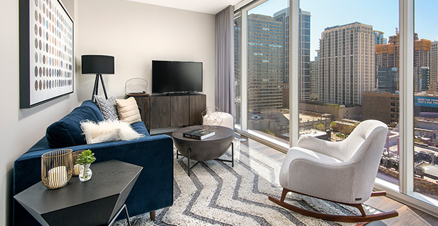 living room with floor to ceiling windows and views of South Loop neighborhood from Eleven40 apartment for rent