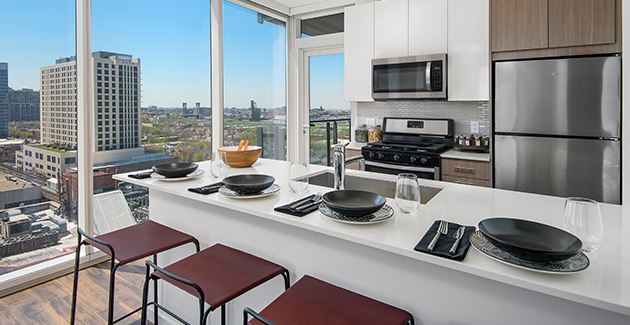 kitchen with view of South Loop neighborhood from Eleven40 South Loop apartments