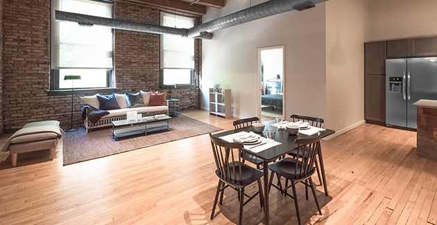 dining area and living room of loft apartment for rent at 120 N Green St, West Loop, Chicago, IL