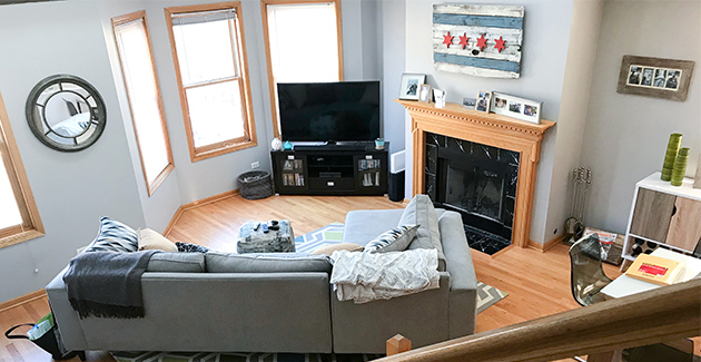 Living room with bay window and fireplace in duplex apartment for rent in Lakeview, Chicago.