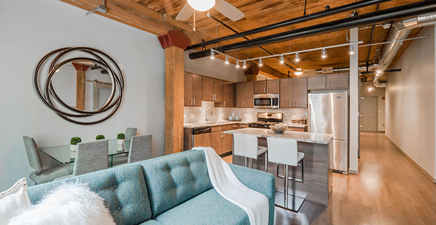 timber beams and hardwood floors in Lofts at River East apartments for rent in Streeterville, Chicago, IL