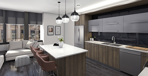 kitchen island with bar stool seating and pendant lights in Loop apartment for rent at Millennium on LaSalle