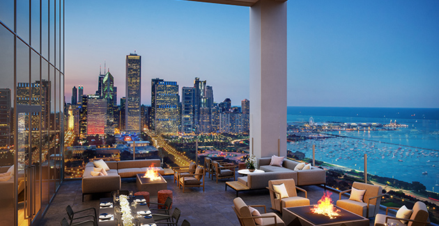 outdoor terrace with fire pits and lounge furniture with view of downtown Chicago, Grant Park and Lake Michigan in South Loop, Chicago