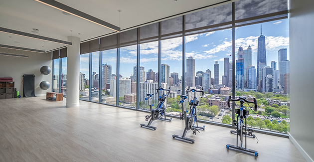 view of Chicago skyline from the Yoga Room at Niche 905 apartments in River North