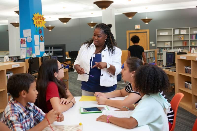 Teacher in Library photo courtesy of Jordan Balderas