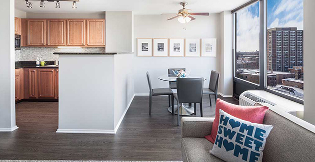 kitchen, dining room and living room of apartment for rent at The Montrose in Uptown Chicago