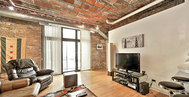 2 bedroom condo loft in the West Loop neighborhood of Chicago with exposed brick walls and ceiling