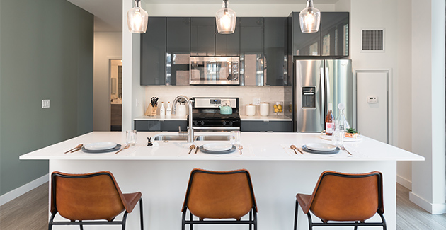 kitchen with dining area in Aurelien Apartments in Gold Coast Chicago