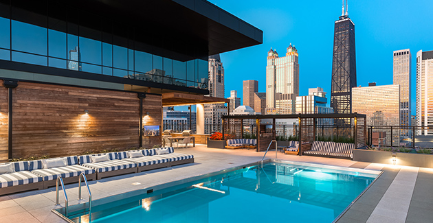 view of Chicago skyline from rooftop pool area of Gold Coast apartment building Aurelien, Chicago, IL