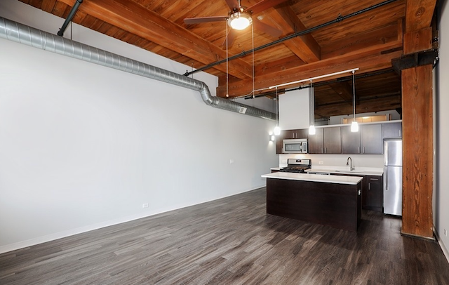 kitchen and living area of loft apartment with timber ceilings in South Loop Chicago