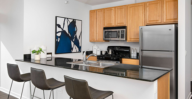 kitchen with breakfast bar and stools in apartment for rent in Fulton Market, Chicago