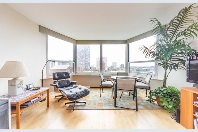 Uptown studio condo for rent with Eames lounge chair and dining set near bay window