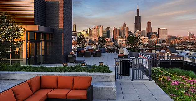 rooftop deck with view of Chicago city skyline in background from The Madison at Racine luxury apartments in the West Loop