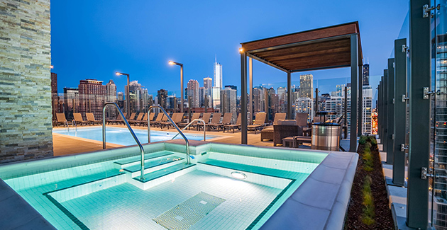 hot tub and rooftop pool on skydeck of luxury River North apartment building in Chicago