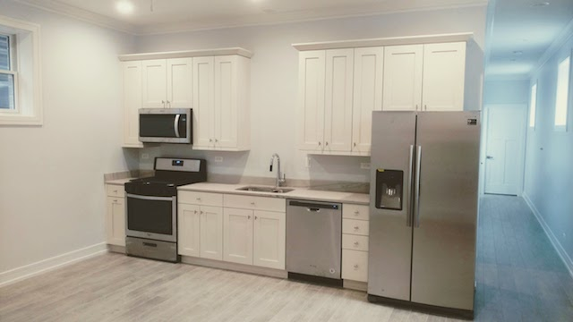 new kitchen with granite counters in North Center apartment for rent