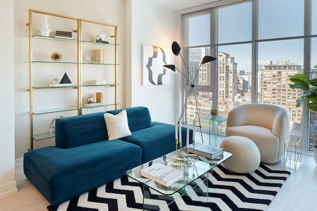 blue sofa and patterned rug in living room of new Chicago apartment in River North