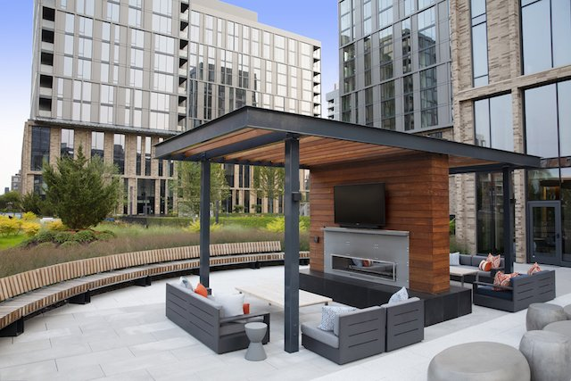 outdoor lounges with firepit and pergola at West Loop apartments for rent
