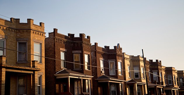 a row of vintage two-flat apartments in Chicago's Avondale neighborhood