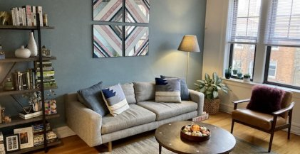 living room of 2 bedroom apartment for rent in Chicago with grey sofa and round coffee table