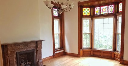 stained glass window and fireplace in Chicago apartment for rent