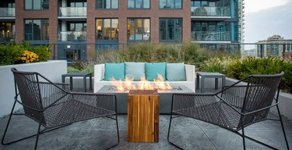 Fire pit on rooftop terrace outside of Chicago apartments