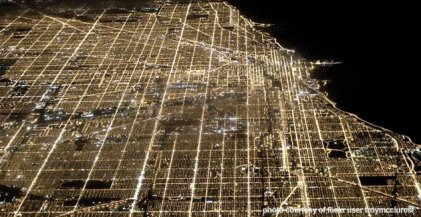 An aerial view of the Chicago street grid system at night