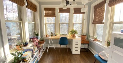 a Chicago apartment with a home office set up in the sun room